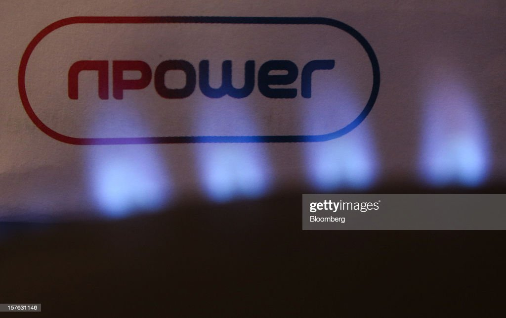 The RWE Npower Plc logo is seen behind natural gas burning on a stove in this arranged photograph taken in Hornchurch, U.K., on Tuesday, Dec. 4, 2012. The regulatory investigation into alleged manipulation in the U.K. gas market, Europe's biggest, may fail to undermine a price-setting system that relies on daily conversations between journalists and traders. Photographer: Chris Ratcliffe/Bloomberg via Getty Images