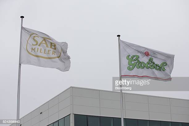The SABMiller Plc and Grolsch logos sit on flags flying outside the Grolsch brewery operated by SABMiller in Enschede Netherlands on Monday April 25...