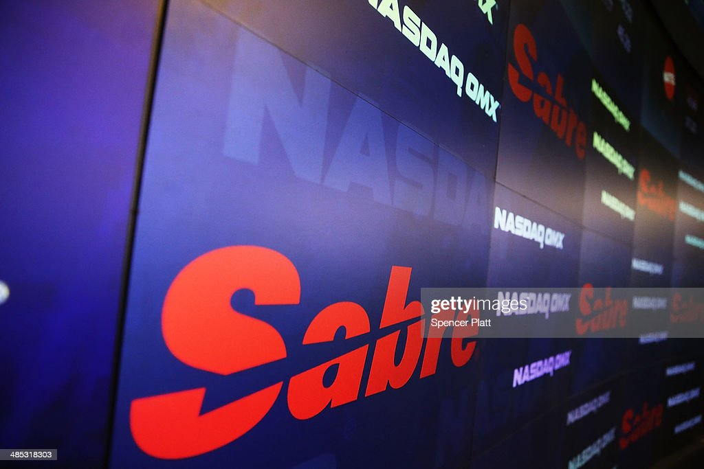 The Sabre symbol is viewed moments after Sabre Corp. made its stock market debut on the Nasdaq exchange on April 17, 2014 in New York City. Shares of Sabre Corp, which owns online travel company Travelocity, rose over 3 percent in their stock market debut .