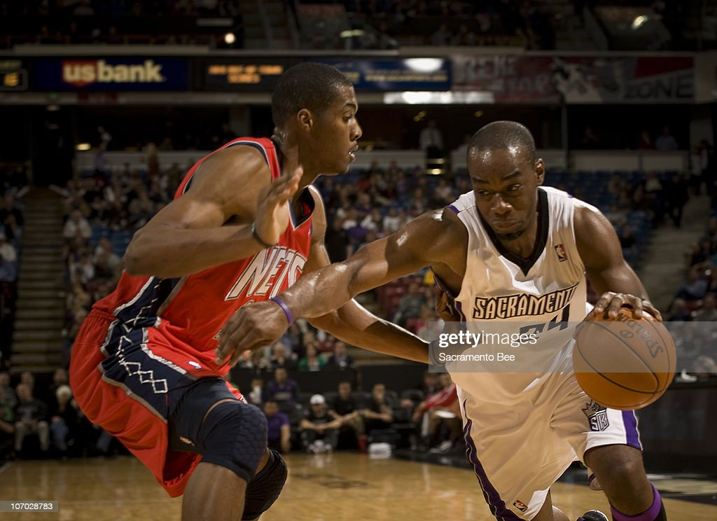 The Sacramento Kings' Carl Landry (24) drives on the New Jersey Nets' Derrick Favors in the first quarter at Arco Arena in Sacramento, California, on Friday, November 19, 2010.