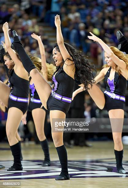 The Sacramento Kings cheer leaders the Sacramento Kings dancers performs against the Denver Nuggets at Sleep Train Arena on November 5 2014 in...