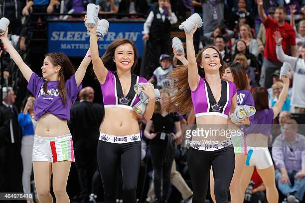 The Sacramento Kings dance team hand out free shirts during the game against the San Antonio Spurs on February 27 2015 at Sleep Train Arena in...
