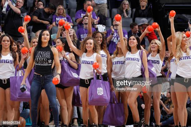 The Sacramento Kings dance team hands out gifts to fans during the game against the Phoenix Suns on April 11 2017 at Golden 1 Center in Sacramento...