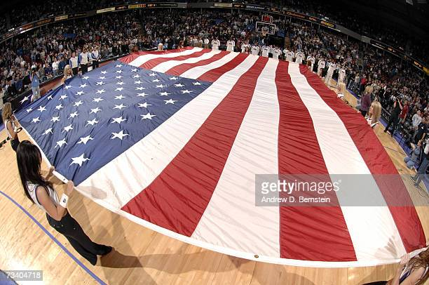 The Sacramento Kings Dance Team holds a giant American Flag during the singing of the National Anthem before the game against the Cleveland Cavaliers...