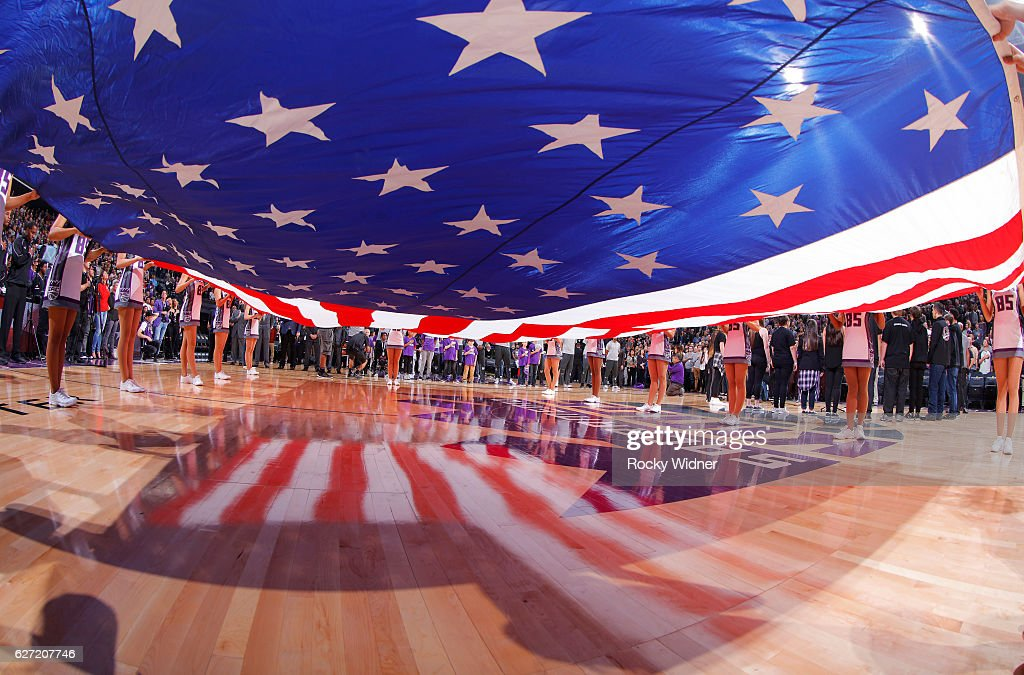 The Sacramento Kings dance team holds up the American flag during the national anthem of the game against the Oklahoma City Thunder on November 23, 2016 at Golden 1 Center in Sacramento, California.