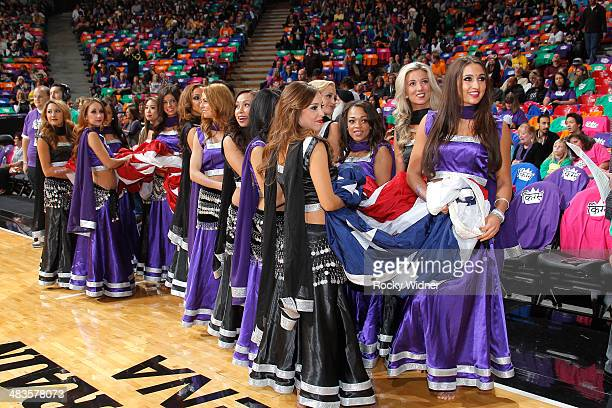 The Sacramento Kings dancers dressed for Bollywood night bring out the American flag for the national anthem during the game against the Los Angeles...