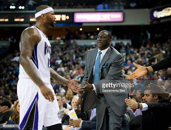 The Sacramento Kings' DeMarcus Cousins expresses his displeasure to head coach Tyrone Corbin after he was given a break against the Milwaukee Bucks...