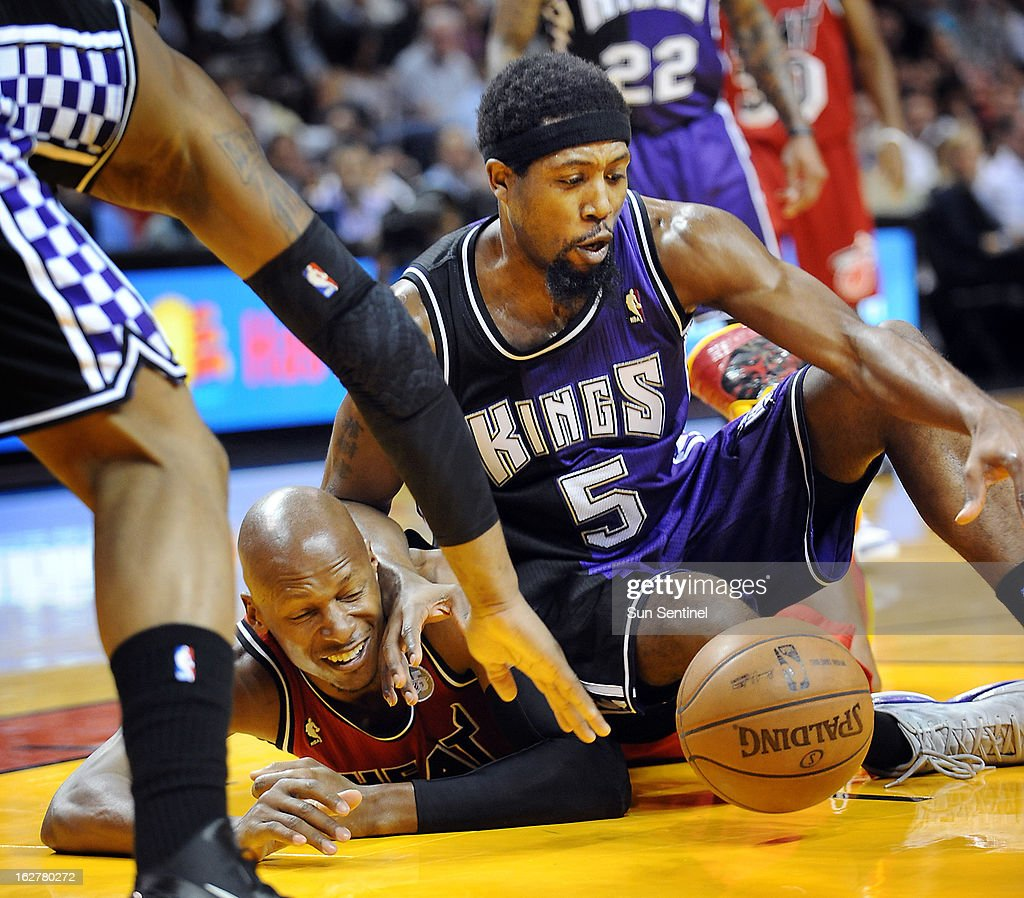 The Sacramento Kings' John Salmons (5) battles for a loose ball against the Miami Heat's Ray Allen during game action at American Airlines Arena in Miami, Florida, Tuesday, February 26, 2013.