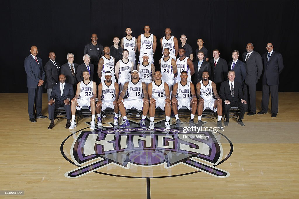 The Sacramento Kings pose for a team photo on April 19, 2012 at Power Balance Pavilion in Sacramento, California. Back Row: Equipment Manager Dwayne Wilson, Strength and Conditioning Coach Daniel Shapiro, Tyler Honeycutt, Hassan Whiteside, Travis Outlaw, Director of Sports Medicine Pete Youngman, Head Athletic Trainer Manny Romero. Middle Row: Alex English, Bobby Jackson, Jim Eyen, Jerry Reynolds, Terrence Williams, Jimmer Fredette, Isaiah Thomas, Marcus Thornton, Tyreke Evans, Video Coordinator Joe Cook, Assistant Vice President of Basketball Operations Mike Petrie, Advance Scout Scott Wissel, Special Assistant Clifford Ray, Vice President and General Manager of Basketball Operations Wayne Cooper. Front Row: Head Coach Keith Smart, Francisco Garcia, John Salmons, DeMarcus Cousins, Chuck Hayes, Jason Thompson, Donte Greene, President Geoff Petrie.