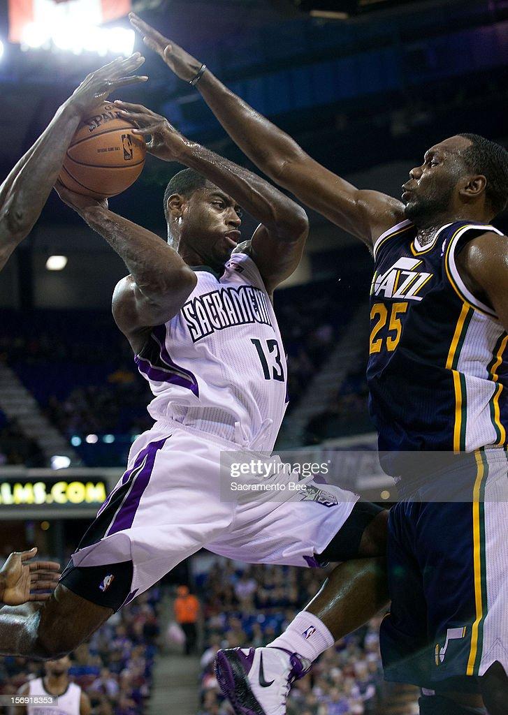 The Sacramento Kings' Tyreke Evans (13) drives against Al Jefferson (25) of the Utah Jazz at Sleep Train Arena in Sacramento, California, on Saturday, November 24, 2012. The Kings topped the Jazz, 108-97.