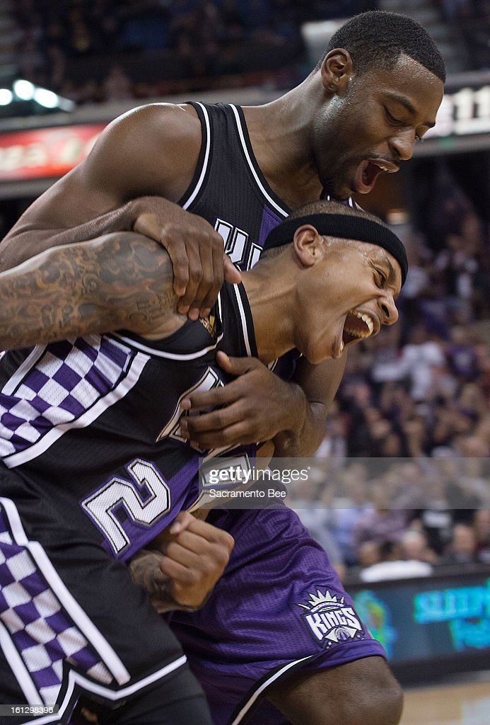 The Sacramento Kings' Tyreke Evans, top, congratulates teammate Isaiah Thomas after he scored a basket to end the first half against the Utah Jazz at Sleep Train Arena in Sacramento, California, on Saturday, February 9, 2013.