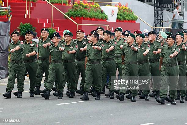 The SAF Veterans League vintage contingent march past during the National Day Parade at Padang on August 9 2015 in Singapore Singapore is celebrating...
