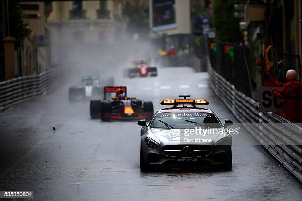 The safety car drives ahead of the field including Daniel Ricciardo of Australia and Red Bull Racing Nico Rosberg of Germany and Mercedes GP and...