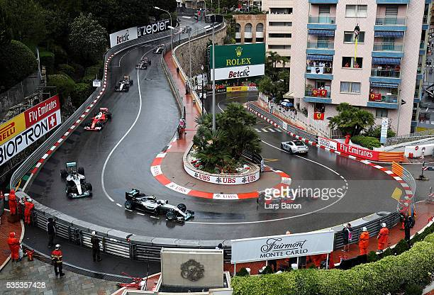 The safety car leads Daniel Ricciardo of Australia driving the Red Bull Racing Red BullTAG Heuer RB12 TAG Heuer Nico Rosberg of Germany driving the...