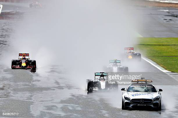 The safety car leads Lewis Hamilton of Great Britain driving the Mercedes AMG Petronas F1 Team Mercedes F1 WO7 Mercedes PU106C Hybrid turbo and the...