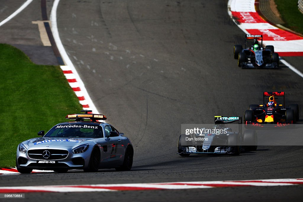 The safety car leads Nico Rosberg of Germany driving the Mercedes AMG Petronas F1 Team Mercedes F1 WO7 Mercedes PU106C Hybrid turbo Daniel Ricciardo...
