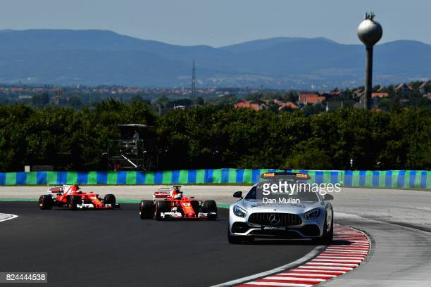 The safety car leads Sebastian Vettel of Germany driving the Scuderia Ferrari SF70H and Kimi Raikkonen of Finland driving the Scuderia Ferrari SF70H...