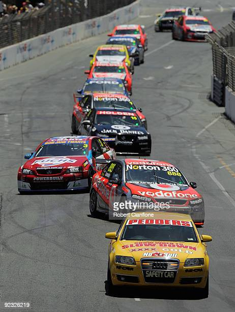 The safety car leads the field around the track during race 20A in round 11 of the V8 Supercar Championship Series at the Surfers Paradise Street...