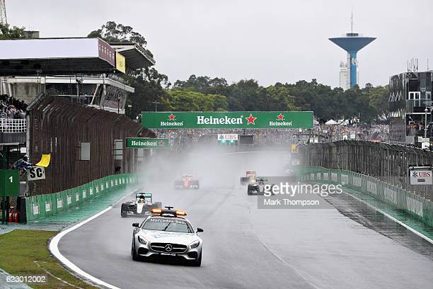 The safety car leads the way at the start in wet conditions during the Formula One Grand Prix of Brazil at Autodromo Jose Carlos Pace on November 13...