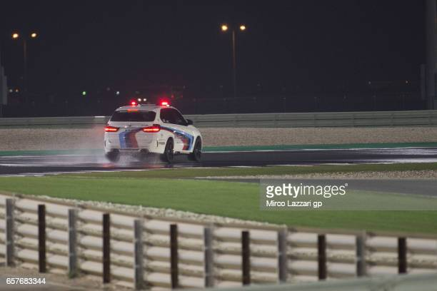 The safety commission in medical car checks the track condition during the MotoGp of Qatar Qualifying at Losail Circuit on March 25 2017 in Doha Qatar