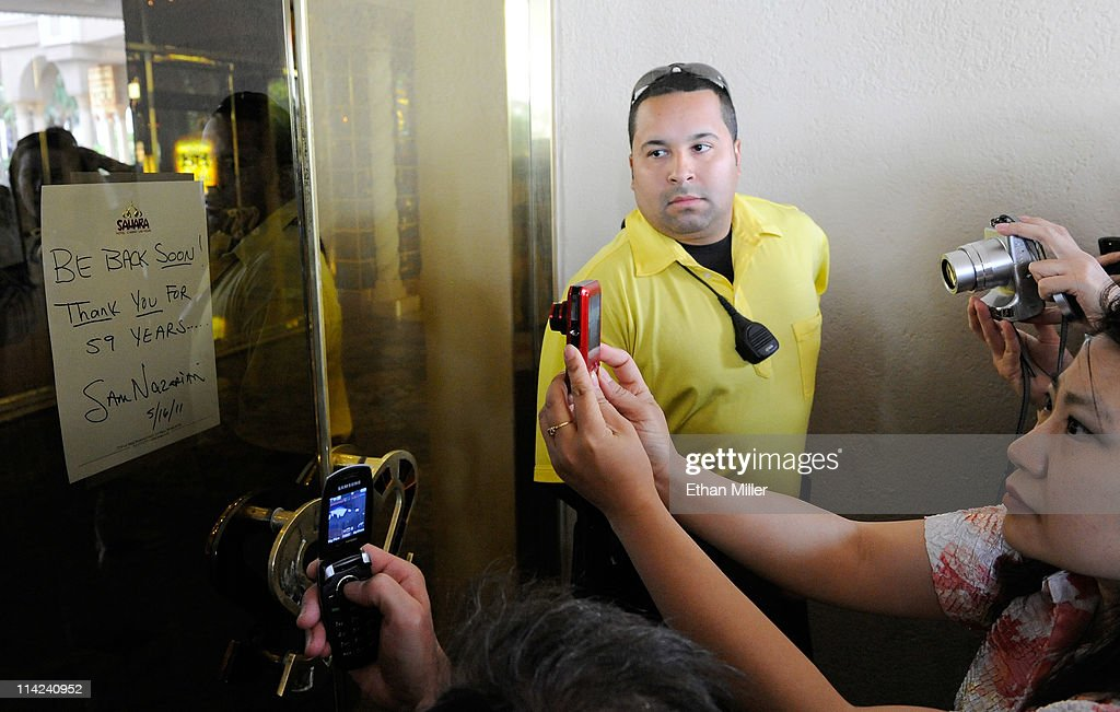 The Sahara Hotel & Casino's last employed bike officer Paul Ramirez stands guard as visitors take photos of a note posted on the front door of the resort by SBE Entertainment Group CEO Sam Nazarian after the property was closed on May 16, 2011 in Las Vegas, Nevada. The Sahara's current owner SBE Entertainment Group closed the 1,720-room resort, which first opened in 1952, and plans to redevelop the site in the future.