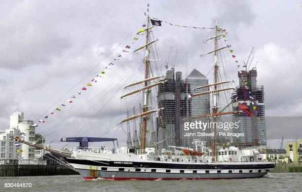 The sail training ship Stavros S Niarchos glides past the Canary Wharf Buildings in east London on her way to the Pool of London The Niarchos is the...