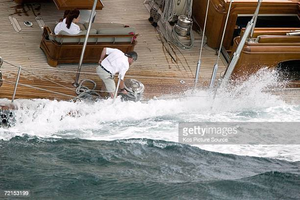 The sail trimmers control the sheet winches holding tons of sail pressure onboard the massive 32 metre Frers designed superyacht Bolero during Race 1...