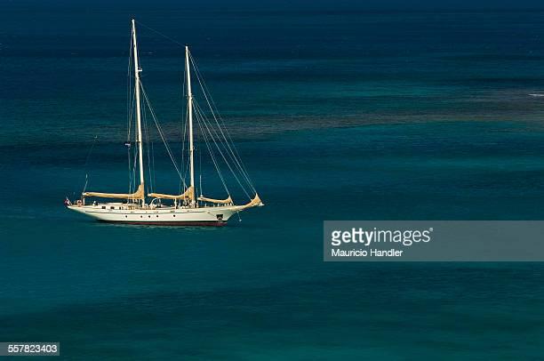 The sailing ship Argo anchored in shallow water in Savannah Bay.