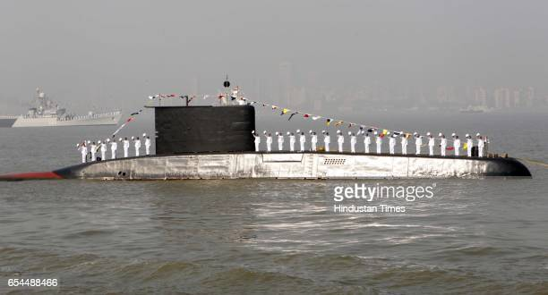 The sailors on board the Indian submarines perform during the President's Fleet Review 2011 in Mumbai on Tuesday