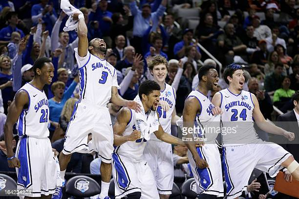 The Saint Louis Billikens bench celebrates in the final moments of their 64 to 44 win over the New Mexico State Aggies during the second round of the...