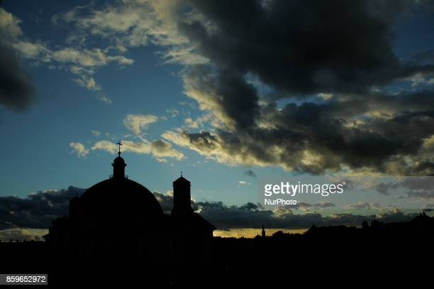 The Saint Vincent de Paul basilica is seen silhouetted against the sky at dusk on October 9 2017