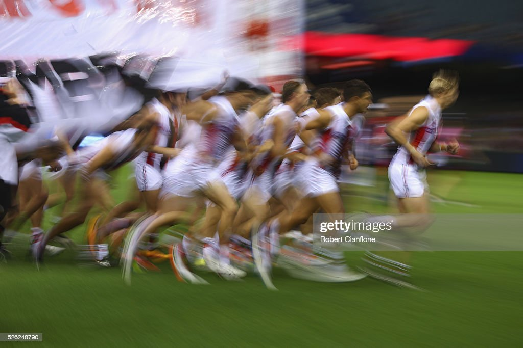 The Saints burst through the banner prior to the round six AFL match between the Melbourne Demons and the St Kilda Saints at Etihad Stadium on April 30, 2016 in Melbourne, Australia.
