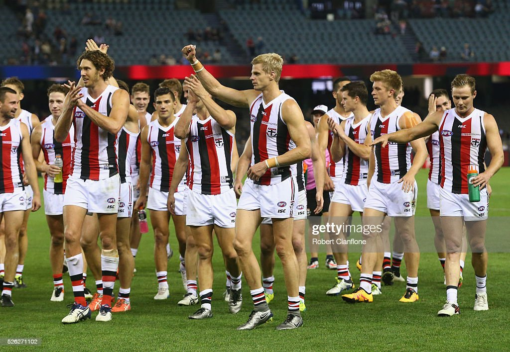 The Saints celebrate after they defeated the Demons during the round six AFL match between the Melbourne Demons and the St Kilda Saints at Etihad Stadium on April 30, 2016 in Melbourne, Australia.
