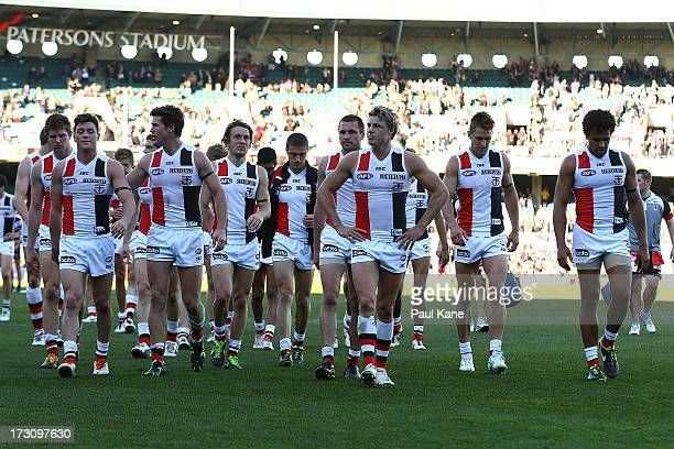 The Saints leave the field after being defeated during the round 15 AFL match between the St Kilda Saints and the Fremantle Dockers at Patersons...