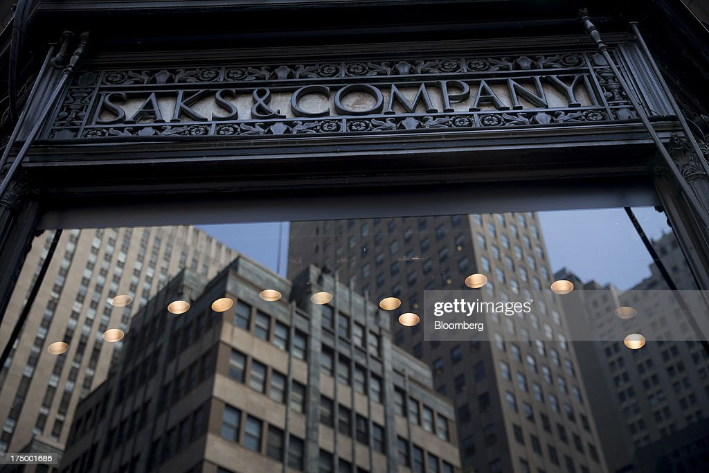 The 'Saks & Company' logo is displayed at Saks Fifth Avenue in New York, U.S., on Monday, July 29, 2013. Hudson's Bay Co. agreed to buy Saks Inc. for $2.4 billion, combining Canada's largest-department store chain with one of the most prestigious U.S. luxury retailers in a deal that may spur the creation of a real estate investment trust. Photographer: Scott Eells/Bloomberg via Getty Images