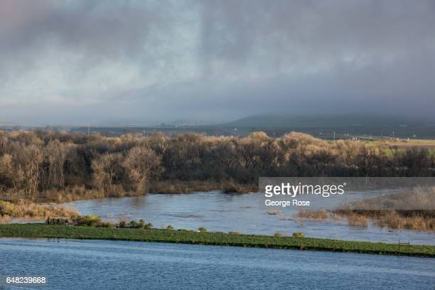 The Salina River is at or above flood stage following a series of heavy storms as viewed on February 22 near King City California Because of its...