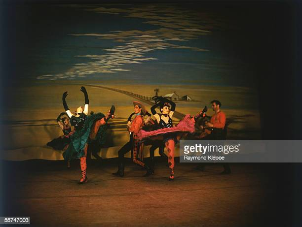 The saloon girls dance the cancan in the dream ballet during a production of 'Oklahoma' at the Theatre Royal Drury Lane 9th August 1947 Original...