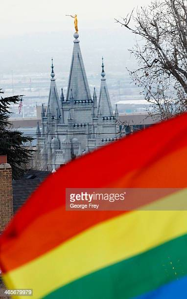 The Salt Lake Temple of the Church of Jesus Christ of LatterDay Saints sits in the background as several hundred people hold a progay marriage rally...
