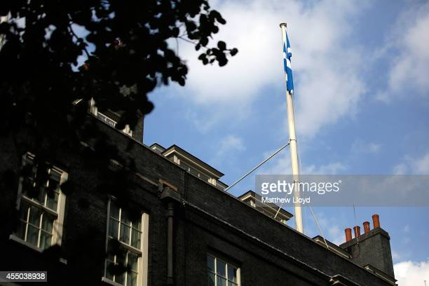 The Saltire flies above 10 Downing Street on September 9 2014 in London England The three main party leaders are tomorrow heading to Scotland to join...