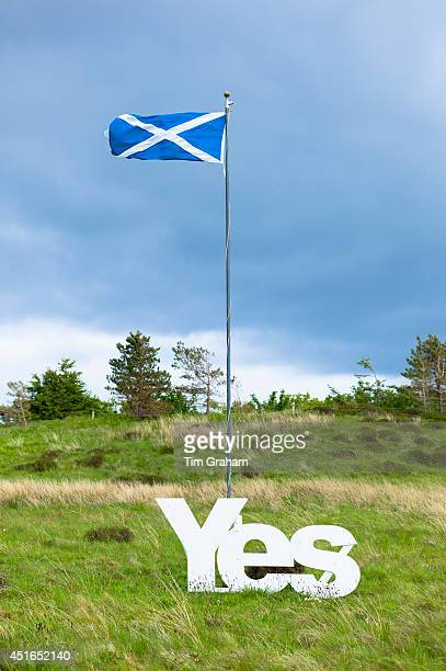 The Saltire national flag of St Andrew flying as Scottish Referendum Independence Debate campaign and lobbying urges voters to give a YES vote for a...