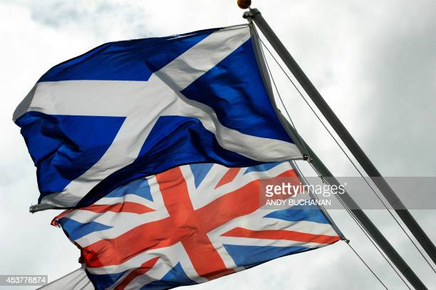 The Saltire the flag of Scotland flies above the Union flag at the site of the Auld Acquaintance cairn which is being constructed at a site on the...