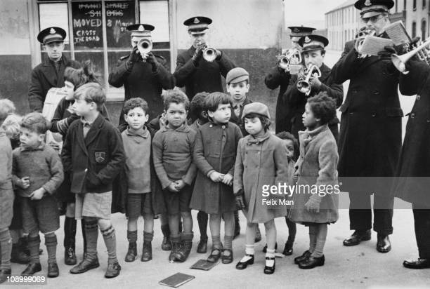 The Salvation Army Band plays to the children of Tiger Bay the dockland area of Cardiff where most of the city's immigrant population live March 1939...