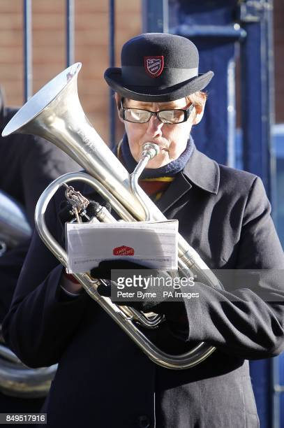 The Salvation Army brass band plays outside Goodison Park before the game