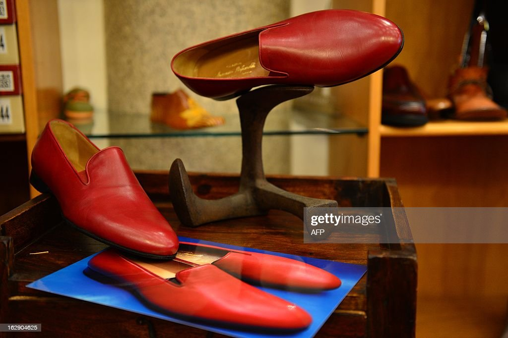 The same model of the shoes worn by Pope Benedict XVI are displayed in Papal shoemaker Adriano Stefanelli's shop on March 1, 2013 in Novara. Stefanelli, who made shoes for Popes John Paul II and Pope Benedict XVI, is also expected to have the next Pope as a customer.