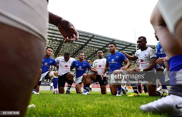 The Samoa and Fiji teams huddle together following the Cup Final match between Fiji and Samoa on day three of the HSBC Paris Sevens at the Stade Jean...