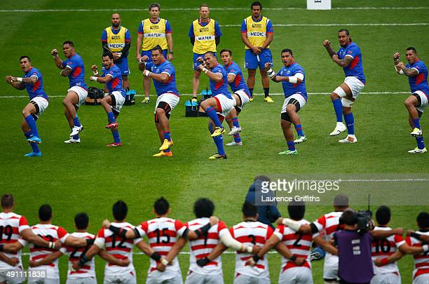 The Samoa team perform the Siva Tau during the 2015 Rugby World Cup Pool B match between Samoa and Japan at Stadium mk on October 3 2015 in Milton...