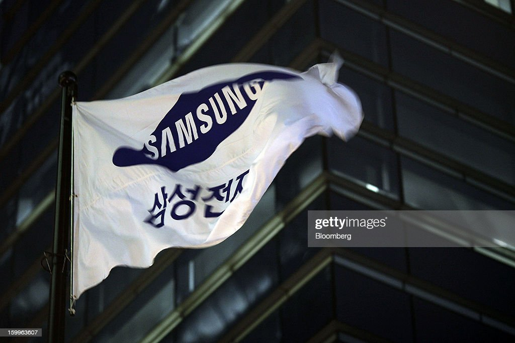 The Samsung Electronics Co. corporate flag flies outside the company's office in Seoul, South Korea, on Wednesday, Jan. 23, 2013. Samsung, in a preliminary statement of results on Jan. 8, reported an 89 percent jump in profit in the three months ended in December, boosted by its Galaxy line of smartphones. Photographer: Woohae Cho/Bloomberg via Getty Images