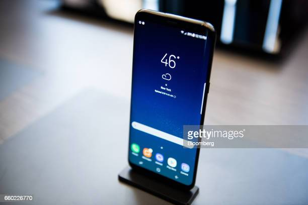 The Samsung Electronics Co Galaxy S8 smartphone is displayed during the Samsung Unpacked product launch event in New York US on Wednesday March 29...