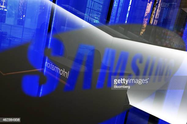 The Samsung Electronics Co logo is displayed at the company's d'light showroom in Seoul South Korea on Tuesday Jan 27 2015 Samsung the world's...