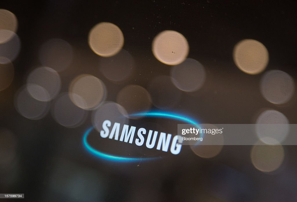 The Samsung Electronics Co. logo is displayed on a computer screen at the company's flagship store in Seoul, South Korea, on Wednesday, Dec. 5, 2012. Samsung Electronics Co. promoted Lee Jae Yong to vice chairman, putting him a step closer to succeeding his father as leader of the world's biggest maker of televisions and mobile phones. Photographer: SeongJoon Cho/Bloomberg via Getty Images